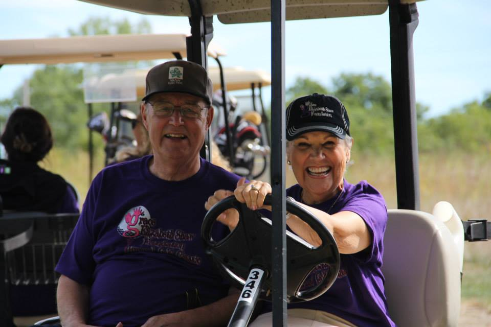 shaw-parents-in-golf-cart